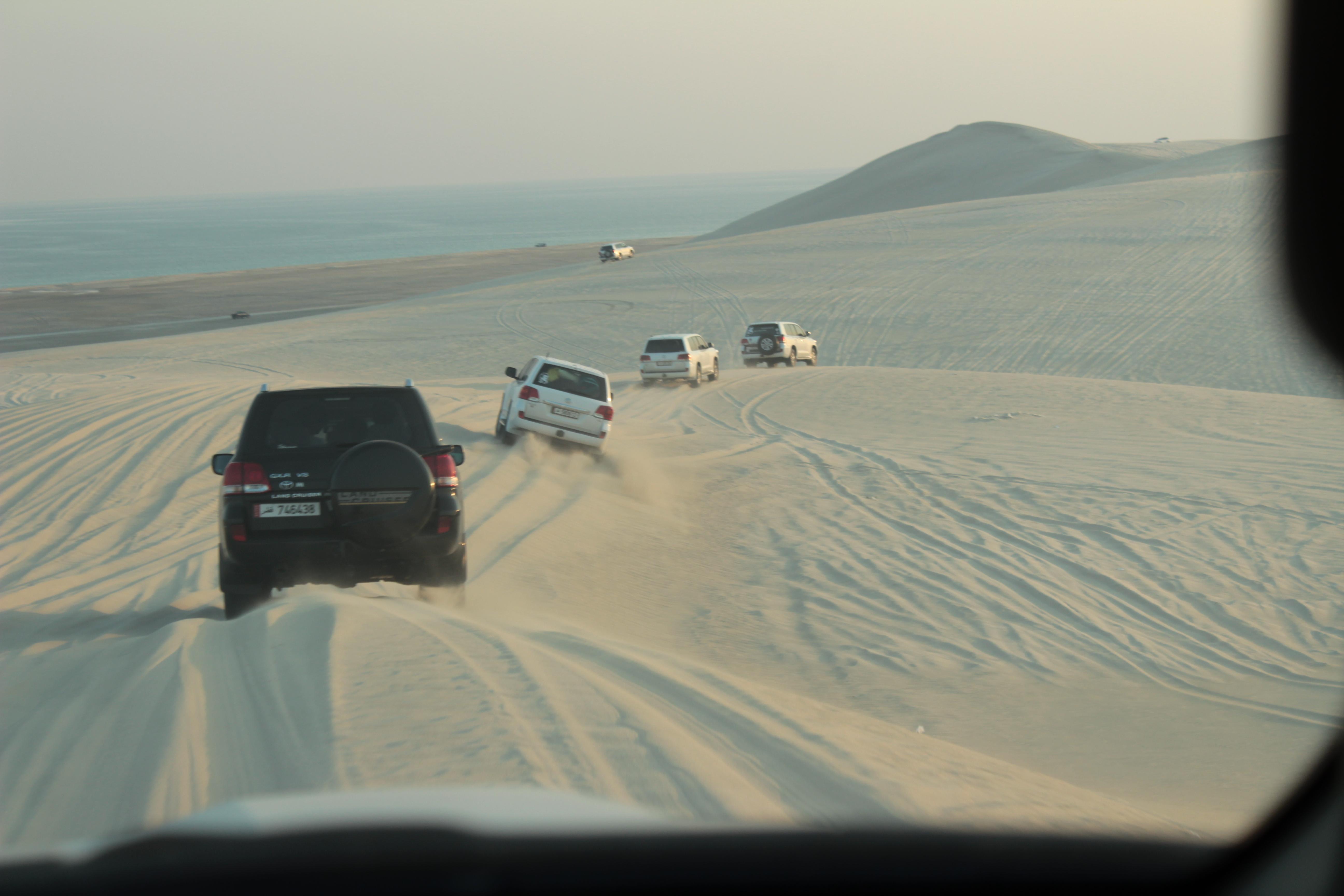 cars driving through the desert