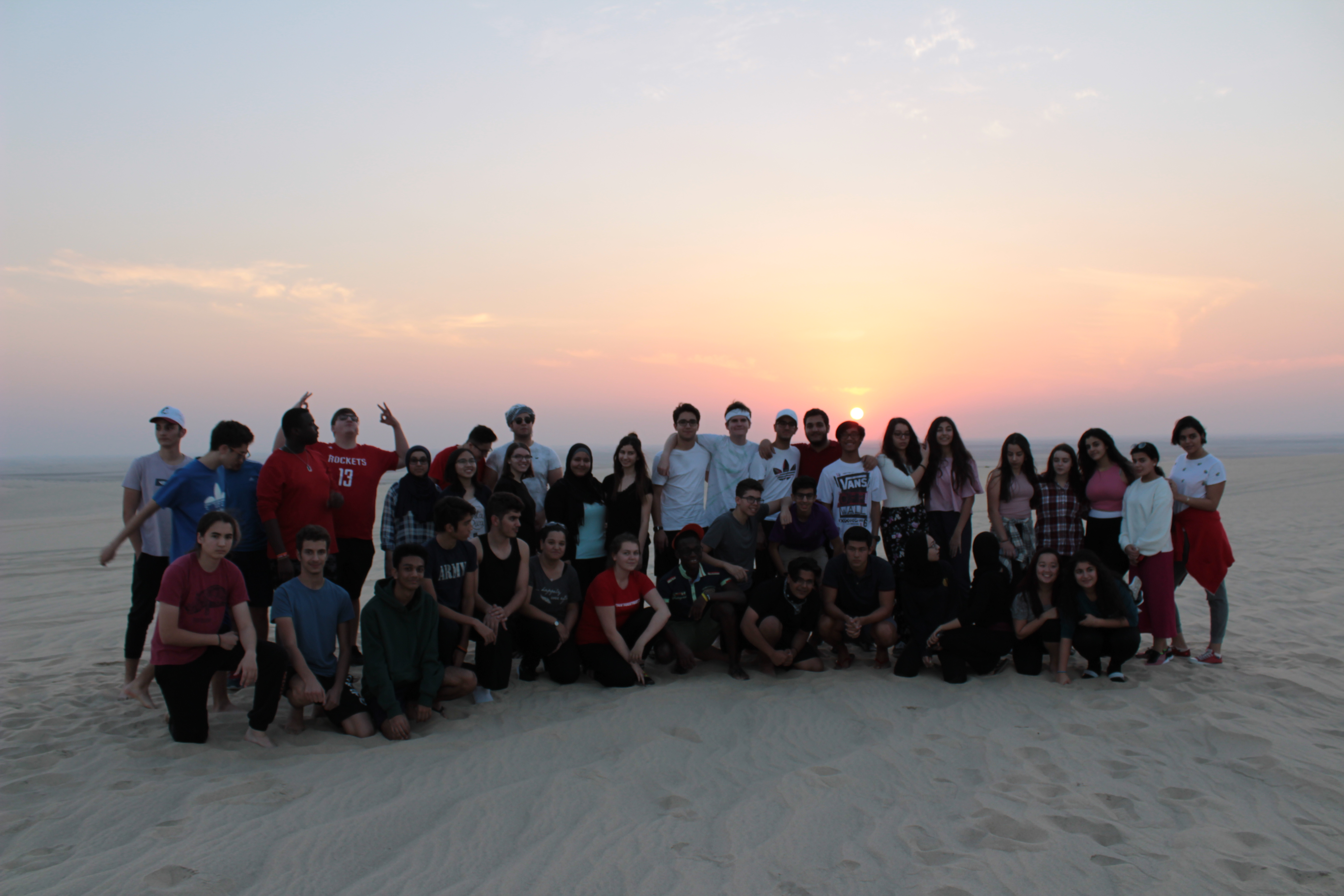 Group photo at sunset in the desert