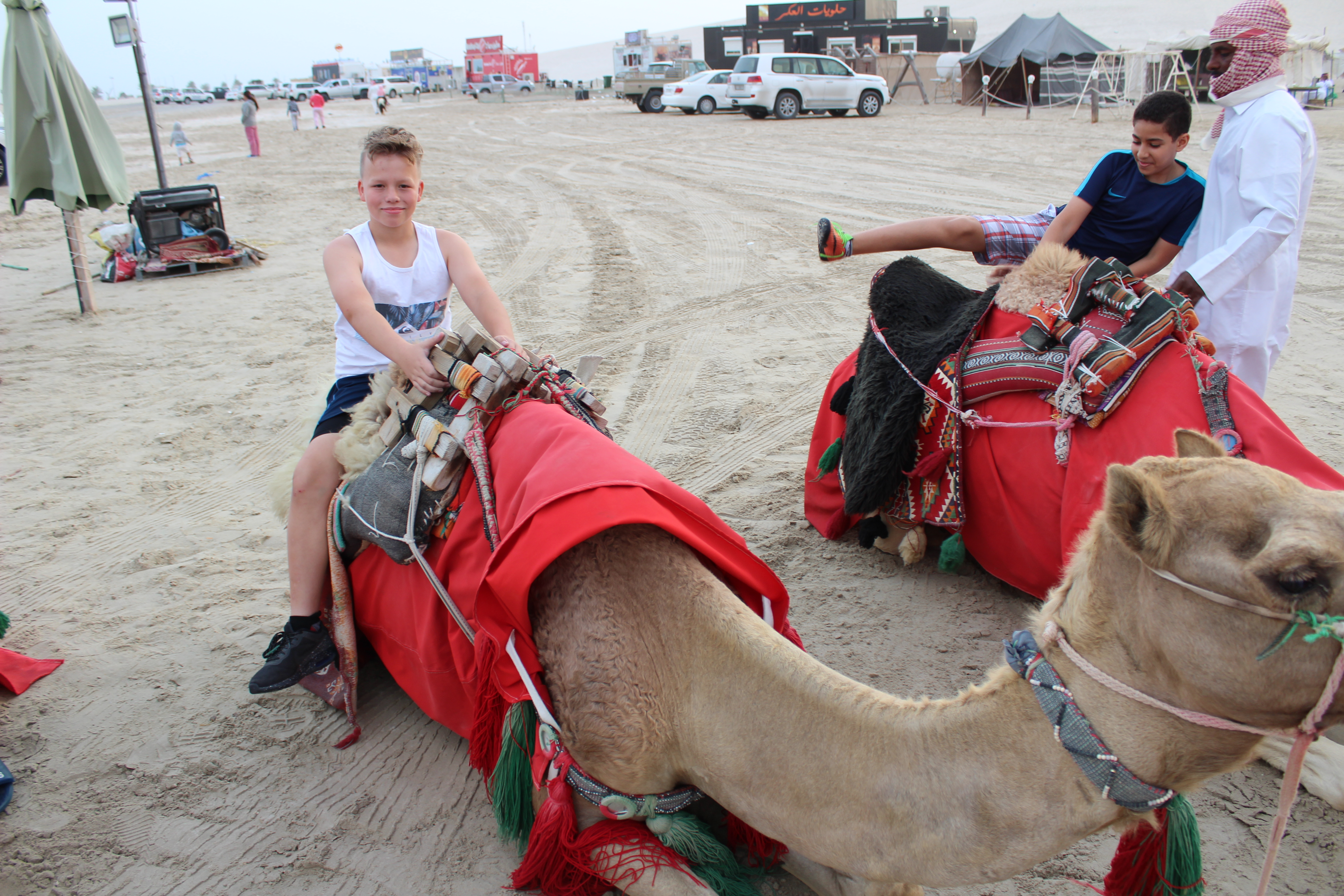 students mounting camels