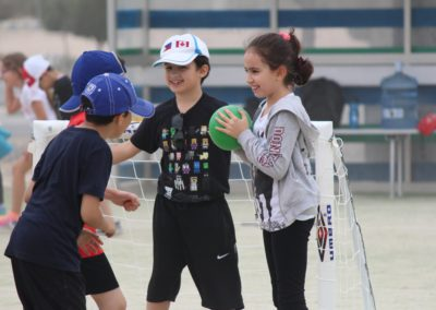 students playing hand ball together