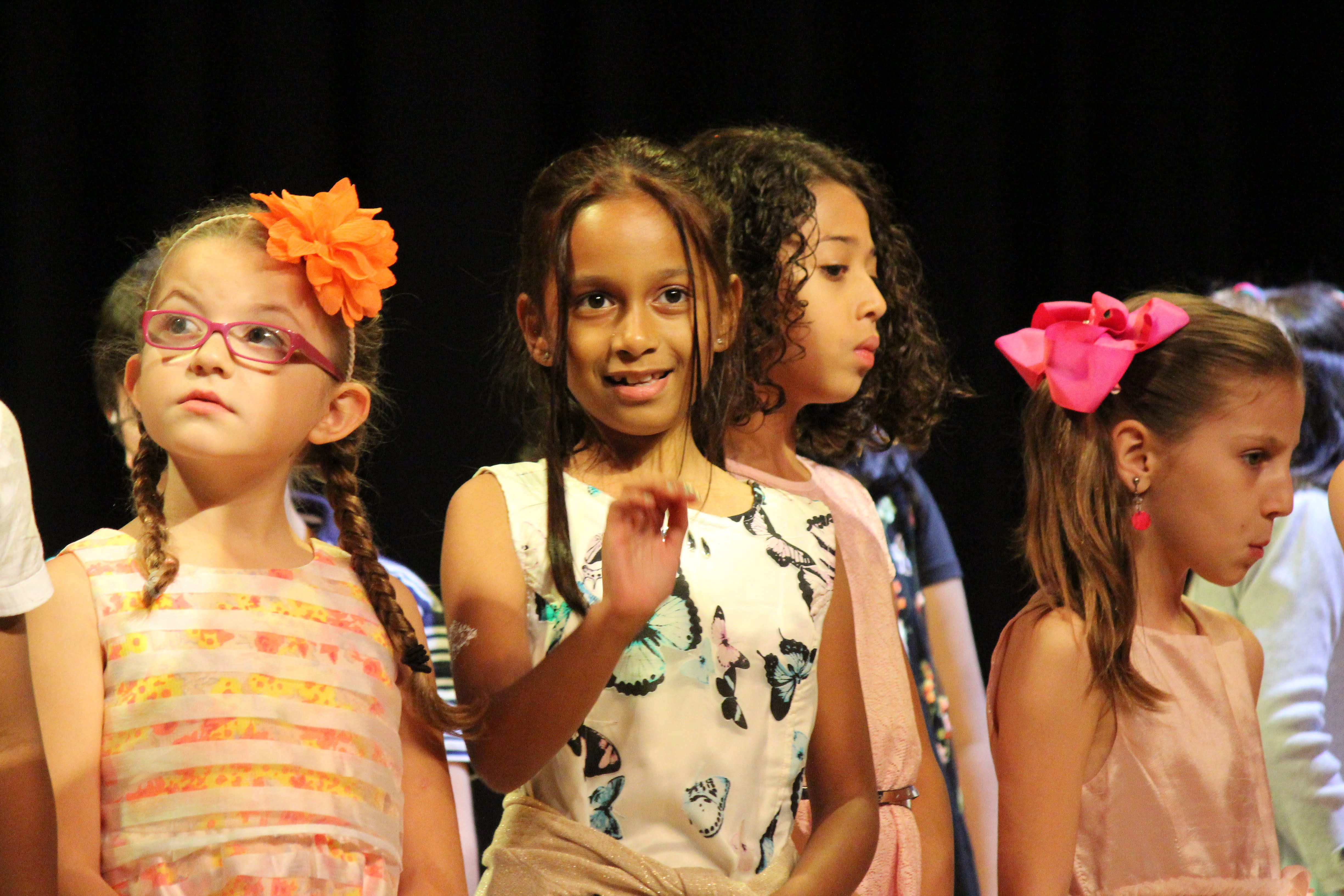 young students on stage performing
